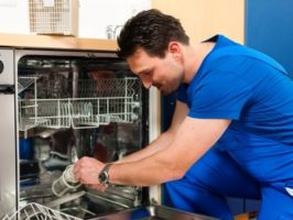 appliance technician repairing the dishwasher
